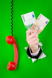Hand with money and phone Royalty Free Stock Image