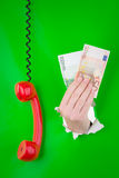 Hand with money and phone Stock Photos