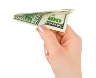 Hand and money plane Stock Photos