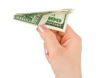 Hand and money plane Stock Photos