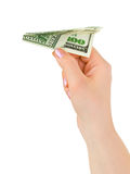 Hand and money plane Stock Photography