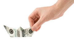 Hand with money ship Stock Photos