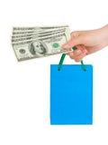 Hand with money shopping bag Stock Photos