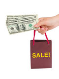Hand with money shopping bag Sale Stock Photo