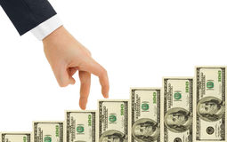 Hand and money staircase Royalty Free Stock Photos