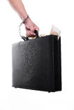Hand with money suitcase Stock Photo