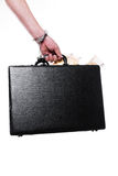 Hand with money suitcase Stock Images