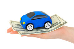 Hand with money and toy car. Isolated on white background Royalty Free Stock Photo