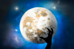 Hand and moon Stock Photography