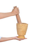 Hand with mortar and pestle Stock Images