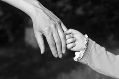 Hand of mother and child Stock Photo