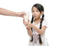 Hand mother  giving her daughter a glass of milk Stock Photo