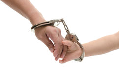 Hand of mother holding her child's hand. Concept of love and family.hand of mother holding her child's hand with handcuff on white background isolated Royalty Free Stock Image
