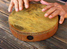 Hand in motion of senior man playing ethnic drum Royalty Free Stock Photo
