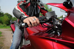 Hand of motorcyclist on country road. Summer royalty free stock photography