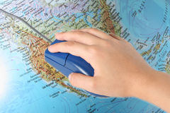Hand with mouse. On the map Royalty Free Stock Images