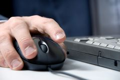 Hand and mouse Royalty Free Stock Image