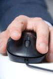 Hand and mouse. Man's hand on a computer mouse Royalty Free Stock Photos