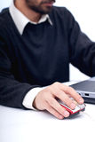 Hand on mouse. Business man at laptop with hand on the mouse in focus, isolated on white Royalty Free Stock Photography