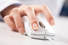 Hand on mouse Royalty Free Stock Photography