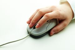 Hand on mouse Stock Photo