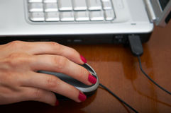 Hand on mouse Stock Photos