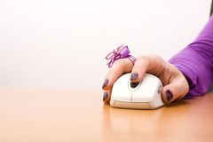 Hand with a mouse device Royalty Free Stock Photography