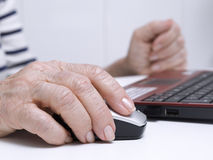 Hand on a mouse. Elderly person's hand on a mouse Stock Images