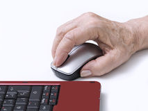 Hand on a mouse. Elderly person's hand on a mouse Royalty Free Stock Photography