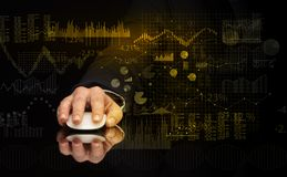 Hand with mouse with financial concept. Hand using wireless mouse with financial concept on dark background stock image