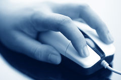 Hand on mouse Royalty Free Stock Images