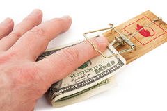 Hand and mousetrap with money. On white background Royalty Free Stock Photo