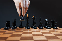 Hand moves chess pawn Royalty Free Stock Images