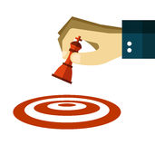 Hand moves a chess pawn to dart target. Stock Photos