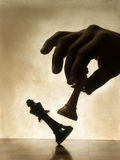 Hand moving chess piece Royalty Free Stock Photos
