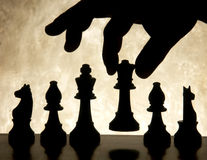 Hand moving chess piece Royalty Free Stock Images