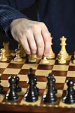 Hand moving pawn on chess board Royalty Free Stock Photo