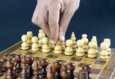 Hand moving a pawn Royalty Free Stock Photos