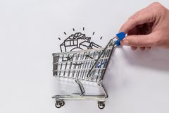 A hand is moving a shopping cart. stock photography