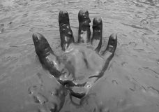 Hand in mud background Stock Photography