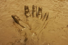 Hand in mud background Royalty Free Stock Photo