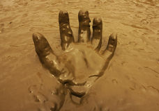 Hand in mud background Stock Photos