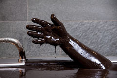 Hand in mud bath for relaxing and healthy Royalty Free Stock Images
