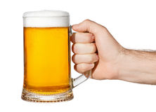 Hand with mug of beer. Isolated on white background. Male hand holding mug of light beer toasting. Hand making toast stock photo