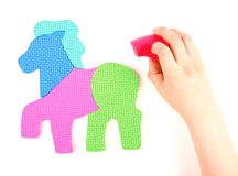 Hand and multicolored foam puzzle Stock Photo