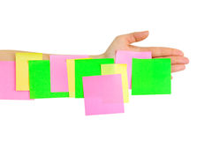 Hand and multicolored note paper Stock Photography