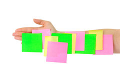 Hand and multicolored note paper Royalty Free Stock Photos
