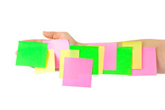 Hand and multicolored note paper Royalty Free Stock Photography