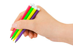 Hand with multicolored pens Stock Images