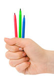 Hand with multicolored pens. Isolated on white background Stock Photo